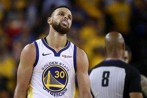 The Golden State Warriors' Stephen Curry reacts during Game Three of the 2019 NBA Finals against the Toronto Raptors.