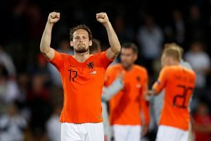 Netherlands' Daley Blind celebrates at the end of the match.