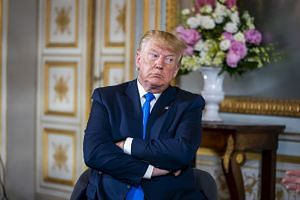 Trump meets French president Emmanuel Macron, not pictured, in Caen, France on June 6, 2019.