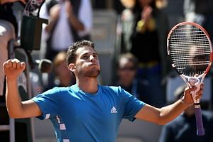 Austria's Dominic Thiem celebrates after winning against Serbia's Novak Djokovic (not pictured) at the end of their men's singles semi-final match of the French Open on June 8, 2019.