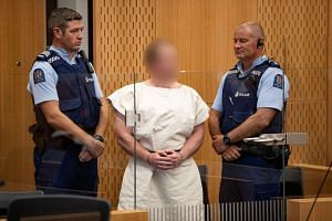 Tarrant makes an appearance in court in New Zealand in March 2019.
