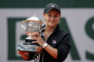 Australia's Ashleigh Barty celebrates with the trophy.