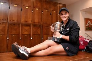 Barty poses with the trophy in the changing room, after defeating the Czech Republic's Marketa Vondrousova.