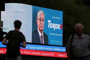 A screen shows an image of Kazakh interim president and candidate Kassym-Jomart Tokayev, part of his campaign ahead of the upcoming presidential election, in Almaty, Kazakhstan, on June 3, 2019.