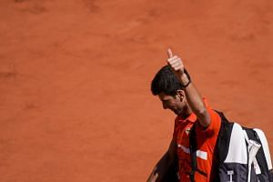 Djokovic leaves the court and acknowledges the audience after losing against Austria's Dominic Thiem.