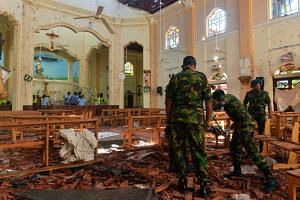 Security personnel inspecting the interior of St Sebastian's Church in Negombo after it was hit by a bomb blast, on April 22, 2019.