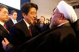 Japan's Prime Minister Shinzo Abe meeting Iran's President Hassan Rouhani during the the World Economic Forum in 2014.