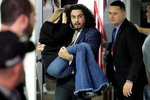 Najila Trindade de Souza, who accuses Brazilian soccer player Neymar of rape, is carried by her lawyer Danilo Garcia de Andrade after giving testimony in a police station, in Sao Paulo, Brazil, on June 7, 2019.