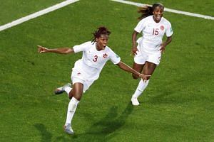 Kadeisha Buchanan (left) came storming in at a corner and delivered a textbook header to break the deadlock.
