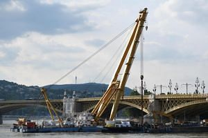 A floating crane on the Danube River in Budapest, on June 10, 2019, ready to lift a boat that sank last week.