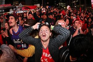 Fans watch the closing moments of the fourth quarter during Game 5 of the NBA Finals at Scotiabank Arena in Toronto, Canada on June 10, 2019.