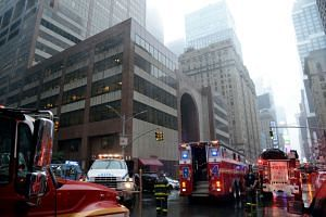 Firefighters responded to 787 Seventh Avenue in Midtown Manhattan after a helicopter crashed on the building's roof.