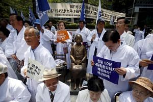 Descendants of Koreans who were conscripted to the Japanese imperial army or recruited for forced labour under Japan's colonisation at an anti-Japan rally in front of the Japanese embassy in Seoul on June 22, 2015.