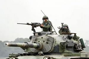 Taiwanese Soldiers on a CM11 battle tank take part in a combat drill in Hsinchu, Taiwan, on May 29, 2019.