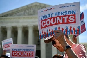 Demonstrators protest against a proposal to add a citizenship question in the 2020 Census at the US Supreme Court.