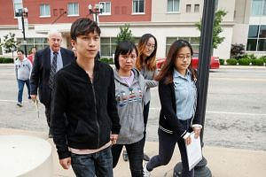The victim's mother, Ye Lifeng (centre), and brother Zhang Zhengyang (left) arrive for the hearing.