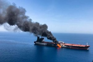 An oil tanker is seen after it was attacked at the Gulf of Oman, on June 13, 2019.