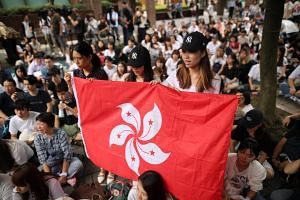 Protestors shouting slogans and displaying the Hong Kong flag during a protest against a Bill that would allow extradition from Hong Kong to mainland China, in Taipei, Taiwan, on June 12, 2019.