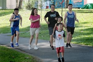 Ashton Ong, five, is taking part in the ST Run with (from left) brother Brigton, 12, mother Christine, 39, father Danny, 43, sister Emilee, nine, and god-brother Damien, 14.