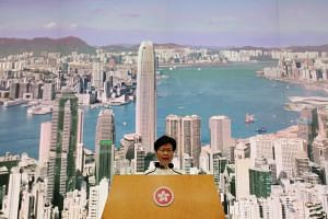 Hong Kong leader Carrie Lam took over in March 2017 when a committee stacked with Beijing loyalists voted her into office - the first time a woman had been elevated to the international finance hub's top job.