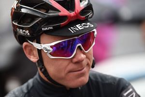 Froome (above) was airlifted to hospital for emergency surgery after slamming into a wall at high speed.