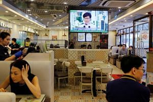 A broadcast of a news conference, in which Hong Kong leader Carrie Lam announced the suspension of a proposed extradition Bill, at a restaurant in Hong Kong on June 15, 2019.