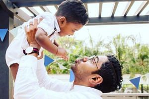 Mr Sivakumar Ramasamy, 32, and his son James. Studies show that there are tangible outcomes from having an actively involved father.