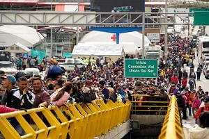 Venezuelans attempting to cross into Ecuador from Colombia at the Rumichaca International Bridge in Tulcan, Ecuador, on June 14, 2019. Most are trying to beat new migration laws that kick in at midnight.