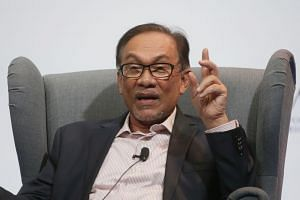 Anwar Ibrahim (above in a file photo) has dismissed talk that his faction is behind a plot to topple Azmin Ali.