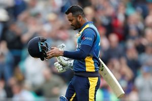 Sri Lanka's Dimuth Karunaratne looks dejected as he walks off the pitch after being caught out by Glenn Maxwell.