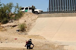 Two Central American migrants crossing the Rio Grande in Mexico last week, before turning themselves in to United States Border Patrol agents to claim asylum. Angry over a surge of Central Americans seeking US asylum, President Donald Trump is pushin