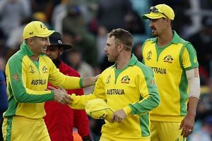 Australia's captain Aaron Finch (second right) celebrates victory with team mates.