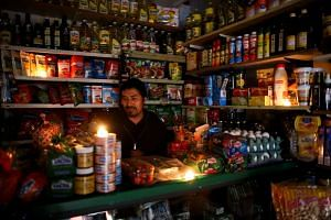 A vendor waits for customers during a national blackout, in Buenos Aires, Argentina.