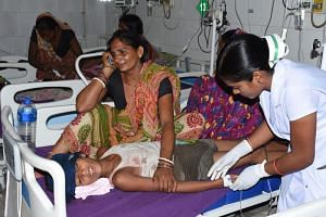A child receives medical treatment due to Acute Encephalitis Syndrome (AES) in a hospital in Muzaffarpur, India, on June 10, 2019.