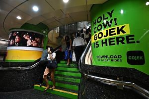 Online middlemen have been providing cheap Gojek bookings for possibly hundreds of passengers daily in the past month. ST PHOTO: LIM YAOHUI
