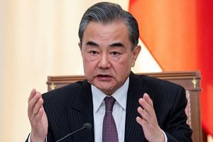 """Chinese State Councillor Wang Yi told reporters that China was """"of course, very concerned"""" about the situation in the Gulf."""