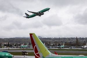 A 737 Max aircraft taking off at the airport next to Boeing's plant in Renton, Washington, on April 11, 2019.