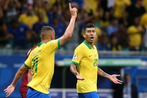 Brazil's Roberto Firmino (right) had a goal chalked off late in the first half after the referee awarded a foul against his team.