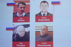 Britain said Russia must cooperate fully with the murder prosecution of the four suspects.