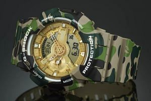 Japanese streetwear purveyor BAPE and Casio celebrated BAPE's 25th anniversary and G-Shock's 35th anniverary with a limited edition watch wrapped in the clothing brand's signature 1st Camo print with gold detailing on the face and back.