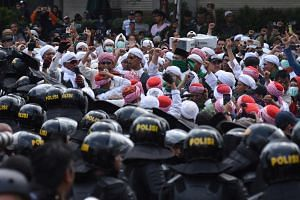 Protesters gather outside the Elections Supervisory Agency office in Jakarta on May 22, 2019. Voting patterns revealed deepening divisions between areas known for a moderate following of Islam and conservative Muslim regions.