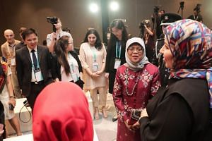 President Halimah Yacob meeting young people working to address challenges of social cohesion in their communities.