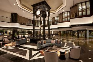 Guests who step into the Orchard Hotel Singapore will be greeted by the hotel's iconic clock tower updated with a contemporary chandelier-inspired art sculpture.