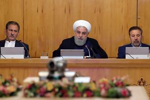 Iranian President Hassan Rouhani (centre) chairs a Cabinet meeting in Teheran, June 19, 2019.