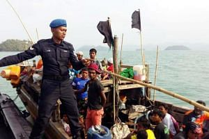 A Malaysian Maritime Enforcement Agency officer on a boat carrying Rohingya refugees on April 3, 2018, after it was intercepted off Langkawi.