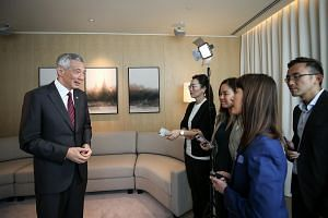 PM Lee Hsien Loong speaking to members of the media at the conclusion of the 34th Asean Summit in Bangkok.