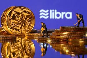 An illustration of the Libra logo with toy figures on representations of virtual currency. Libra will disrupt and weaken nation states by enabling people to move out of unstable local currencies and into a currency denominated in dollars and euros an