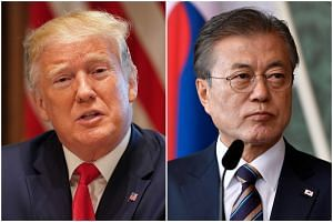 US President Donald Trump (left) will hold a summit with South Korea President Moon Jae-in in South Korea, the Blue House said.