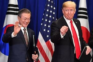 """United States President Donald Trump and South Korean President Moon Jae-in at a bilateral meeting in New York last September, where they signed a trade agreement. Mr Trump is set to meet Mr Moon in Seoul on Sunday, when they will discuss """"ways to wo"""