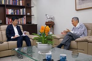 Prime Minister Lee Hsien Loong speaking with Mr Takashi Nakano, Singapore bureau chief of the Nikkei Asian Review. PM Lee said Japan has a very large elderly population, and Singapore will reach that point in a decade. PHOTO: MCI